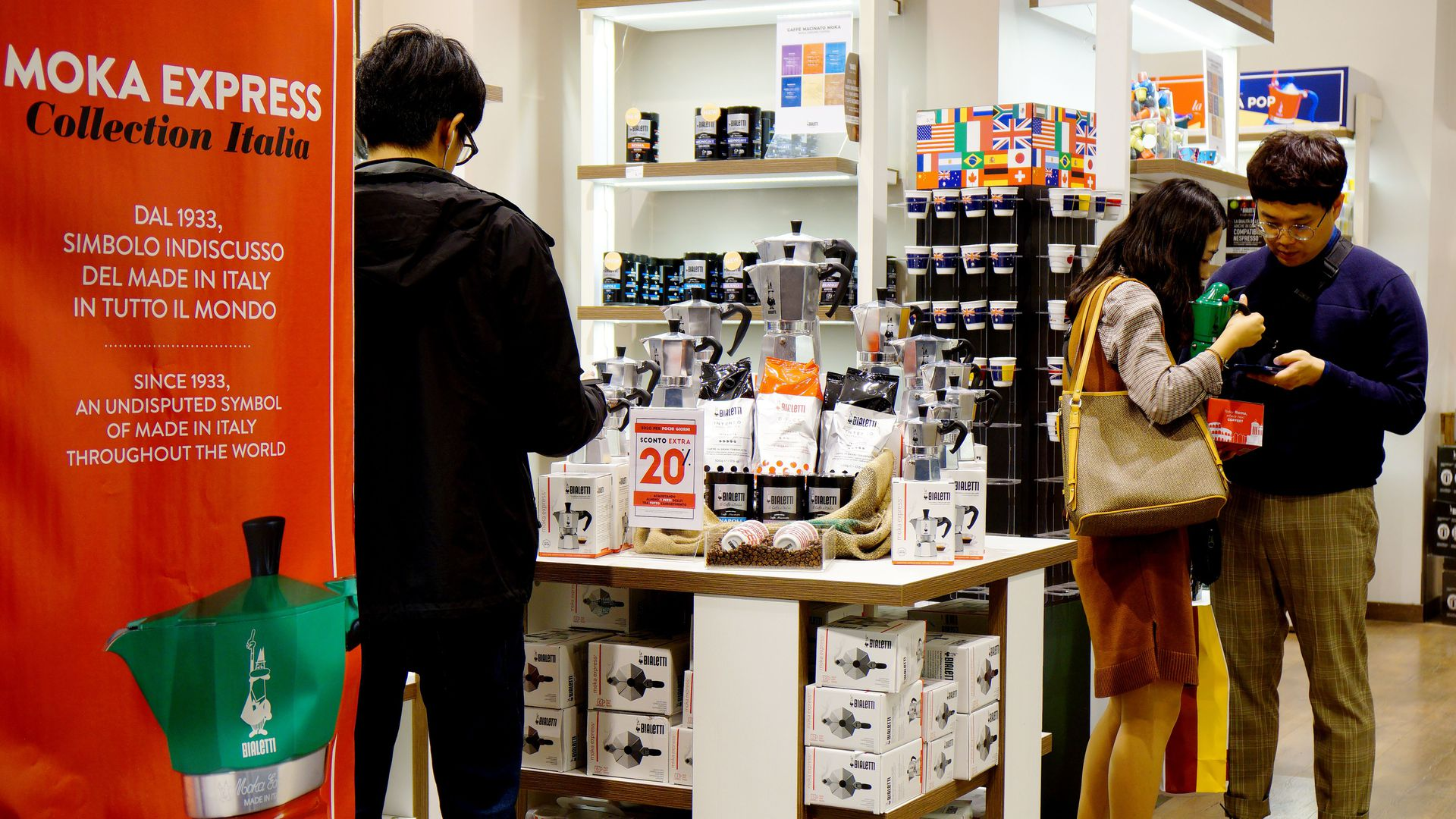 Shoppers in Rome looking at a coffee product.