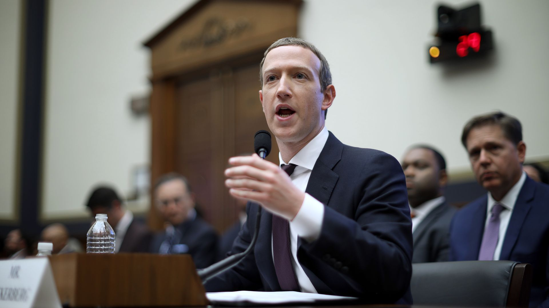 Photo of Facebook CEO Mark Zuckerberg testifying before the House Financial Services Committee