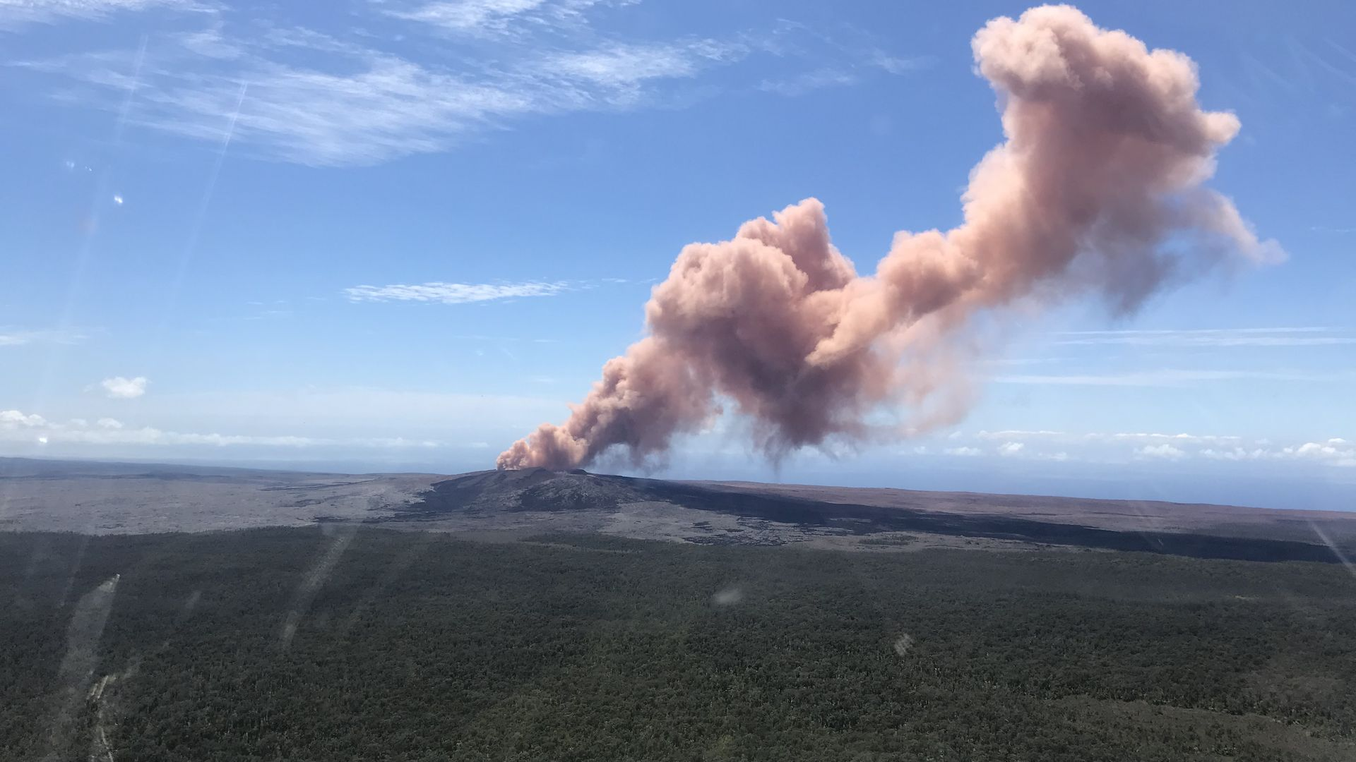 Ash sprews from the Puu Oo crater on Hawaii's Kilauea volcano on May 3