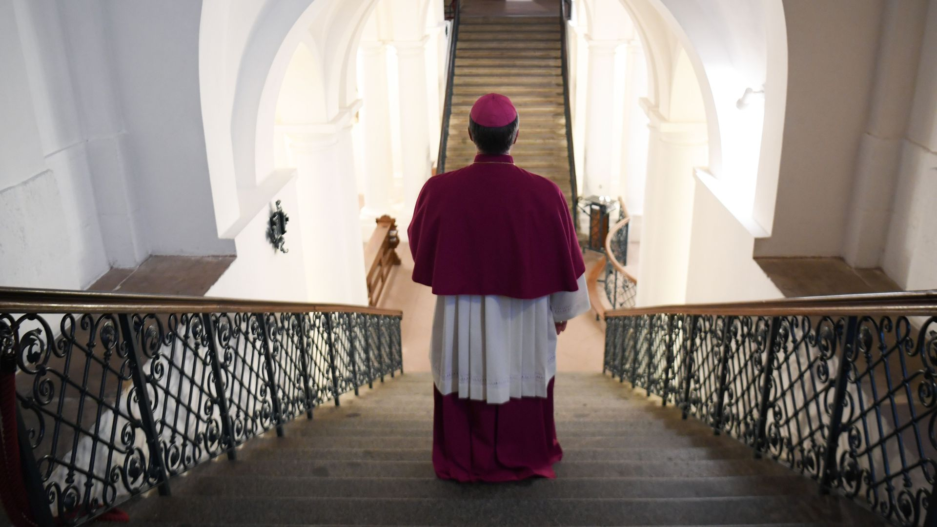 A German bishop is seen from behind.