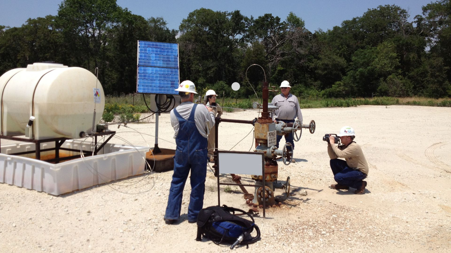 Researchers examine methane emissions from an oil or gas facility.
