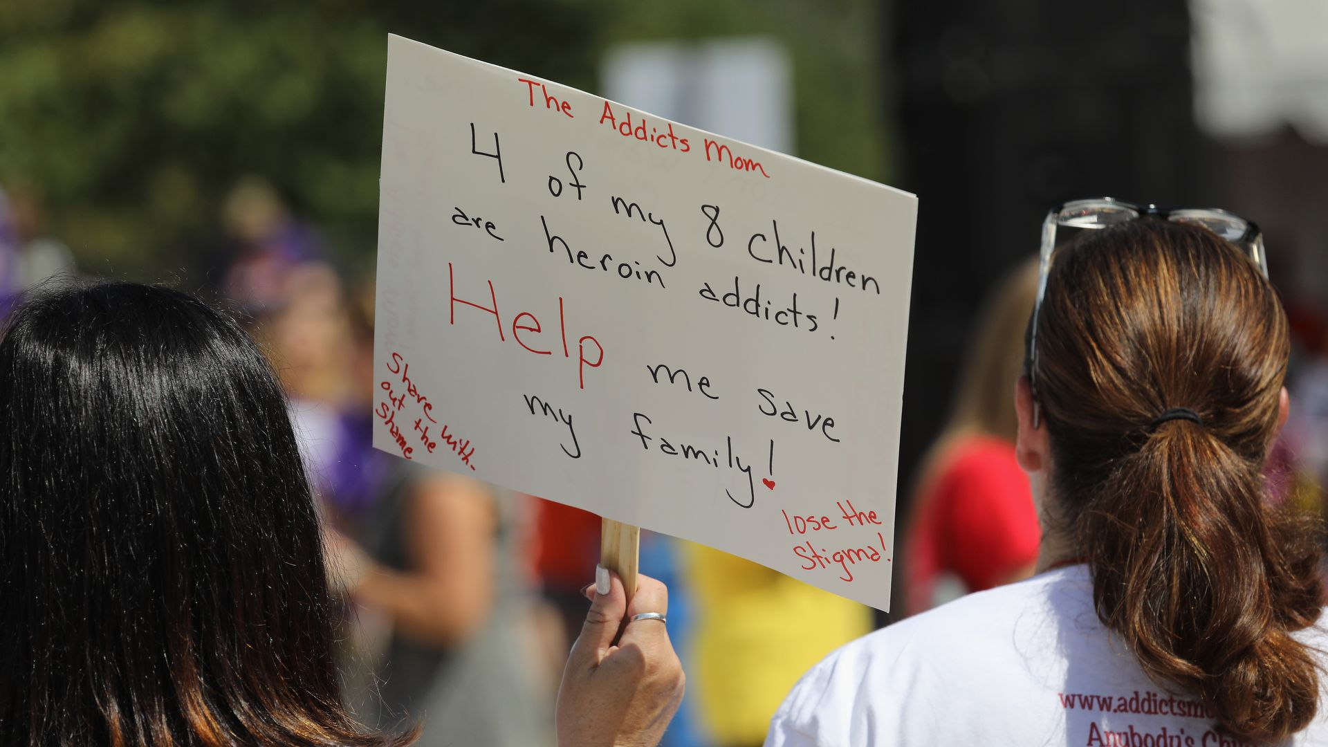 A woman attends a rally against the opioid epidemic
