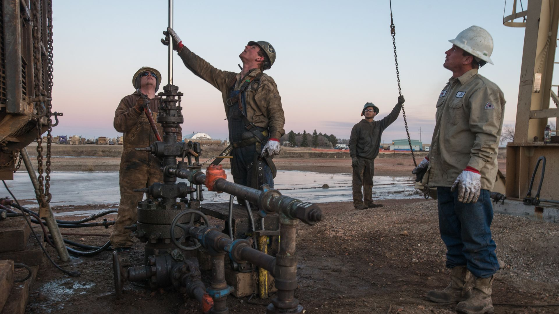 Three oil workers at a fracking site in North Dakota