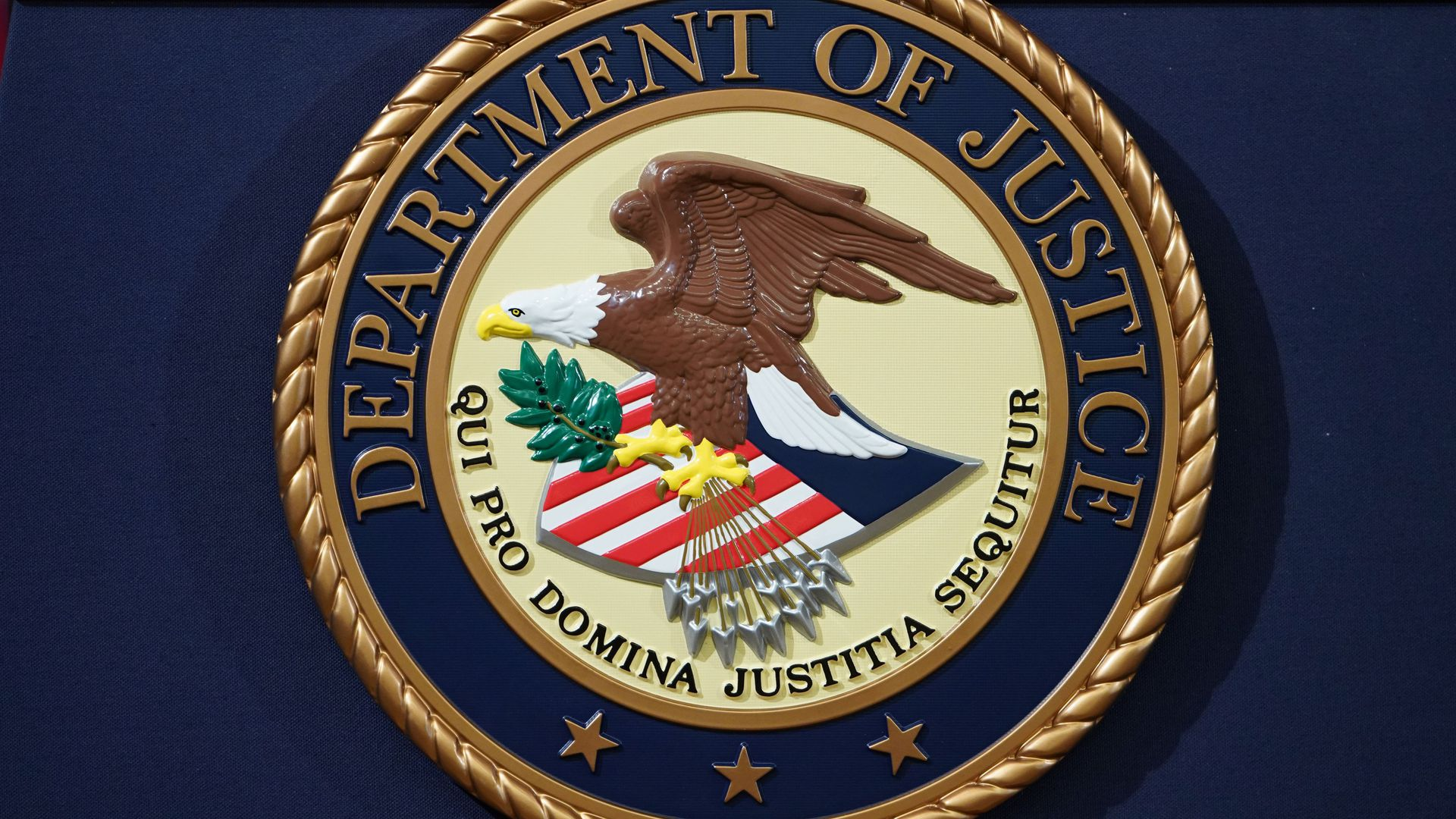 This image is a close-up of the Department of Justice seal.