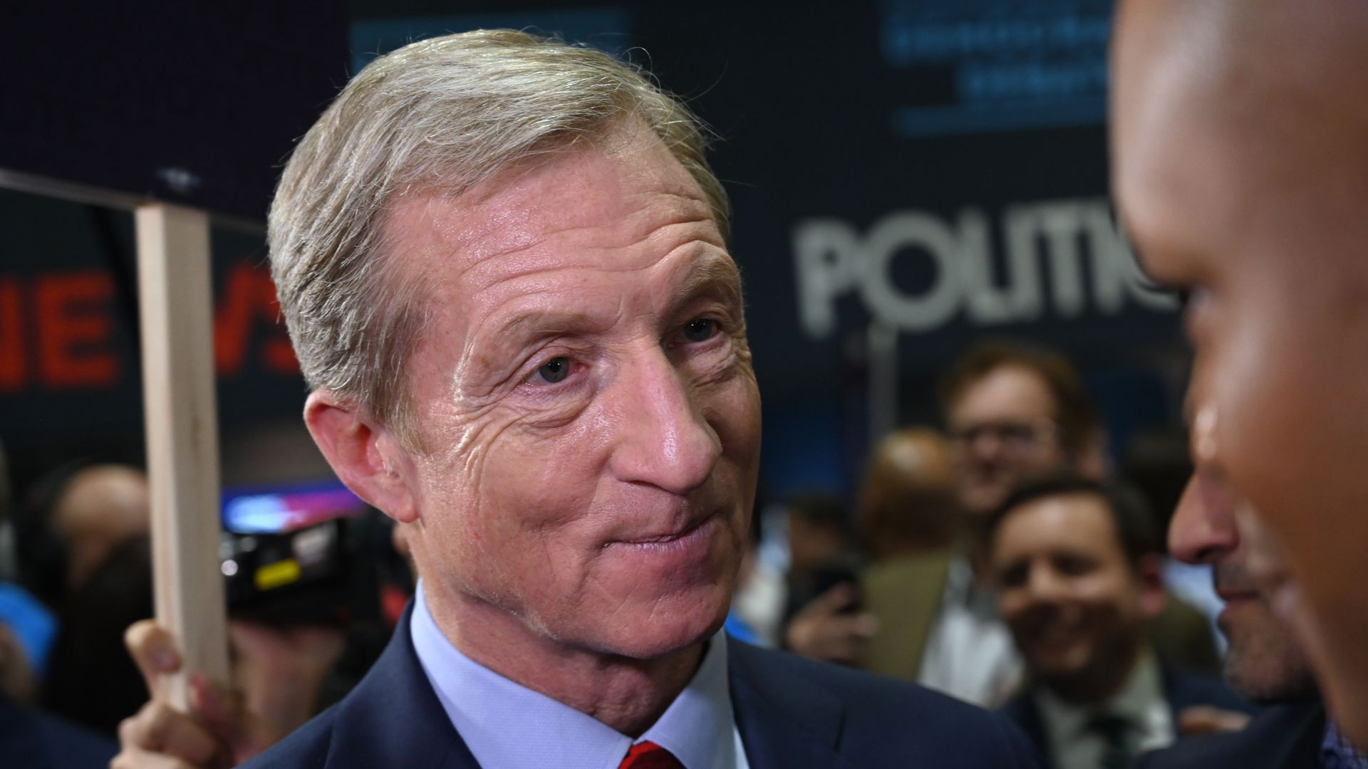 Tom Steyer speaks to reporters after a Democratic debate