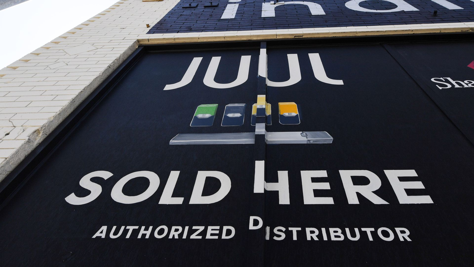 A sign advertising Juul vaping products.
