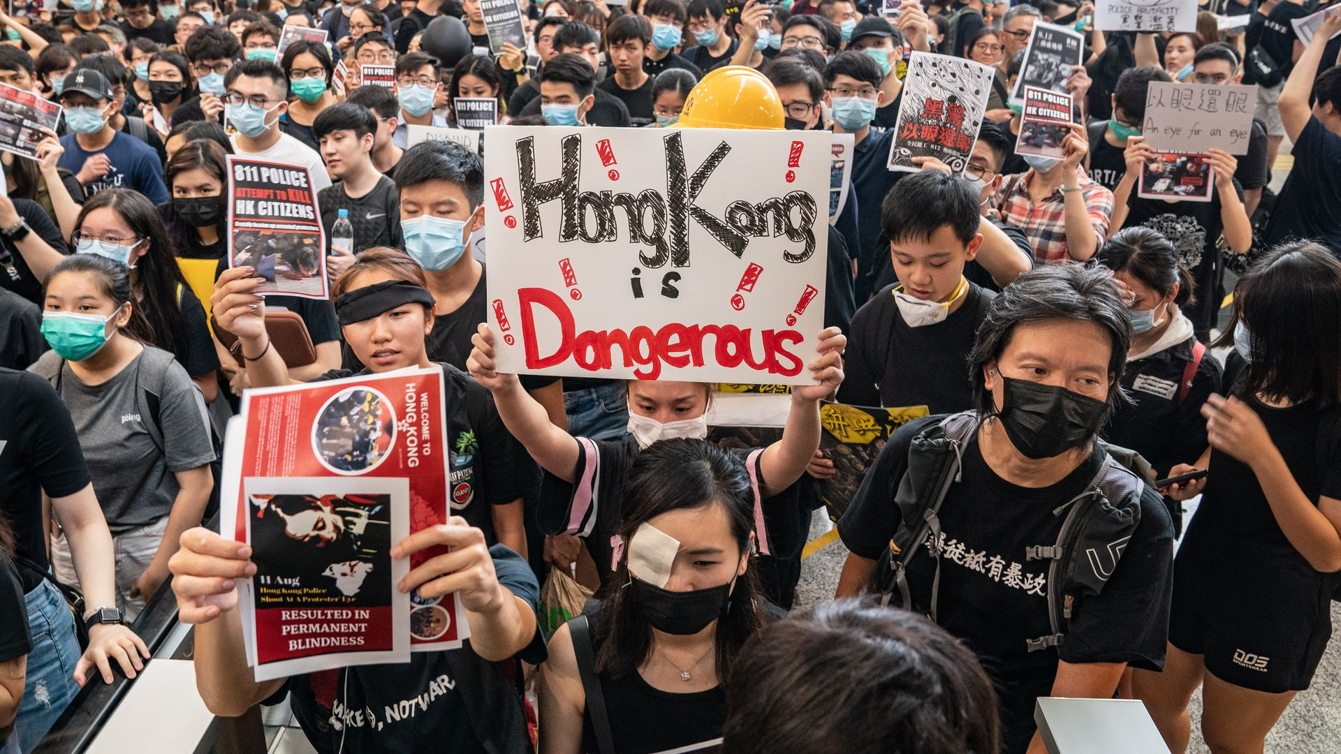 Hong Kong protesters occupy the arrival hall of the Hong Kong International Airport during a demonstration