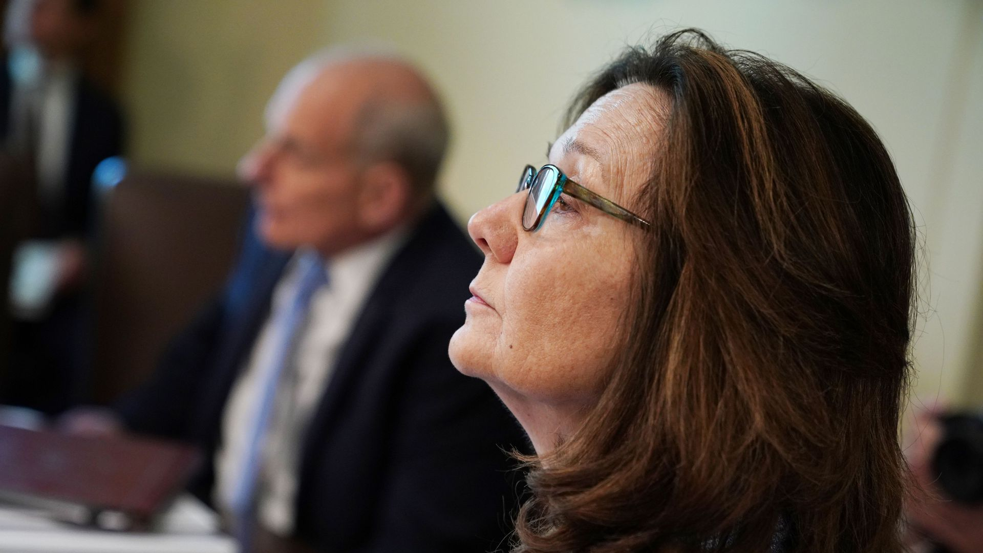 Gina Haspel sitting sideways from the camera.