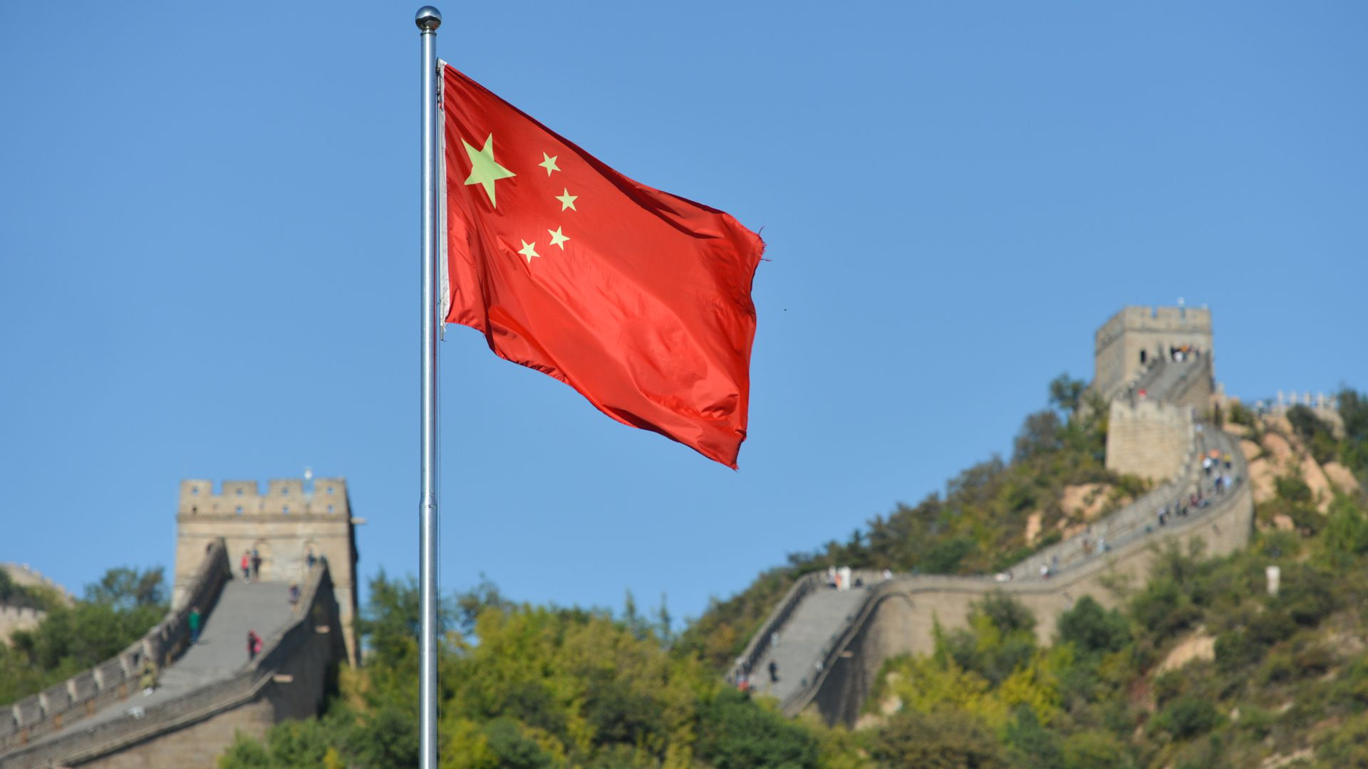 The Chinese National Flag is photographed in front of Badaling, the most visited section of the Great Wall of China