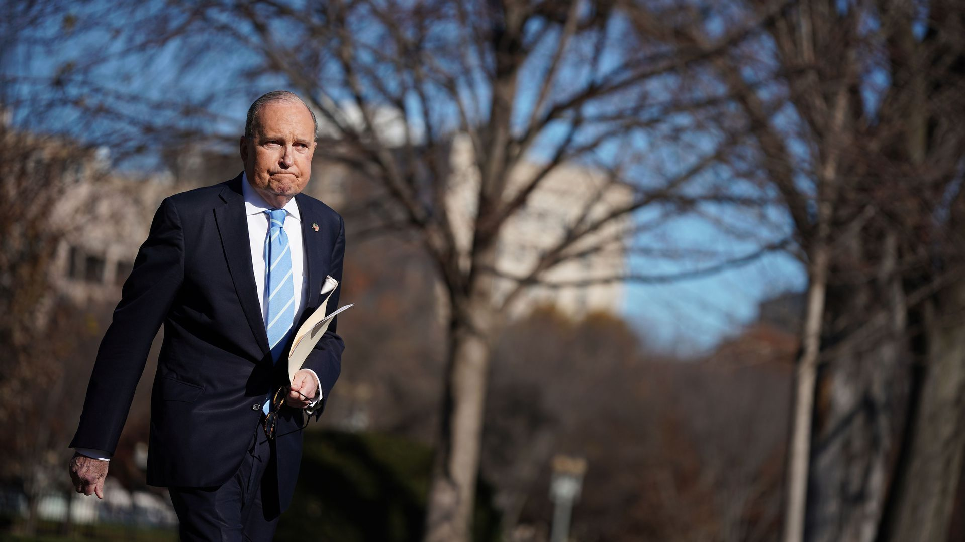 Larry Kudlow walks on the White House South Lawn.