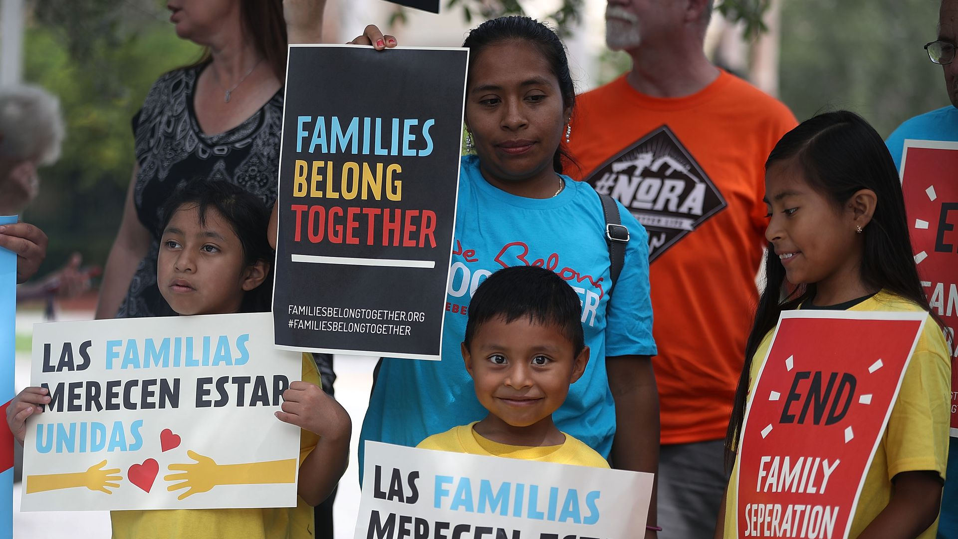 Protesters join together during a rally in front of the Miramar ICE detention facility on the National Day of Action for Children on June 1, 2018 in Miramar, Florida.