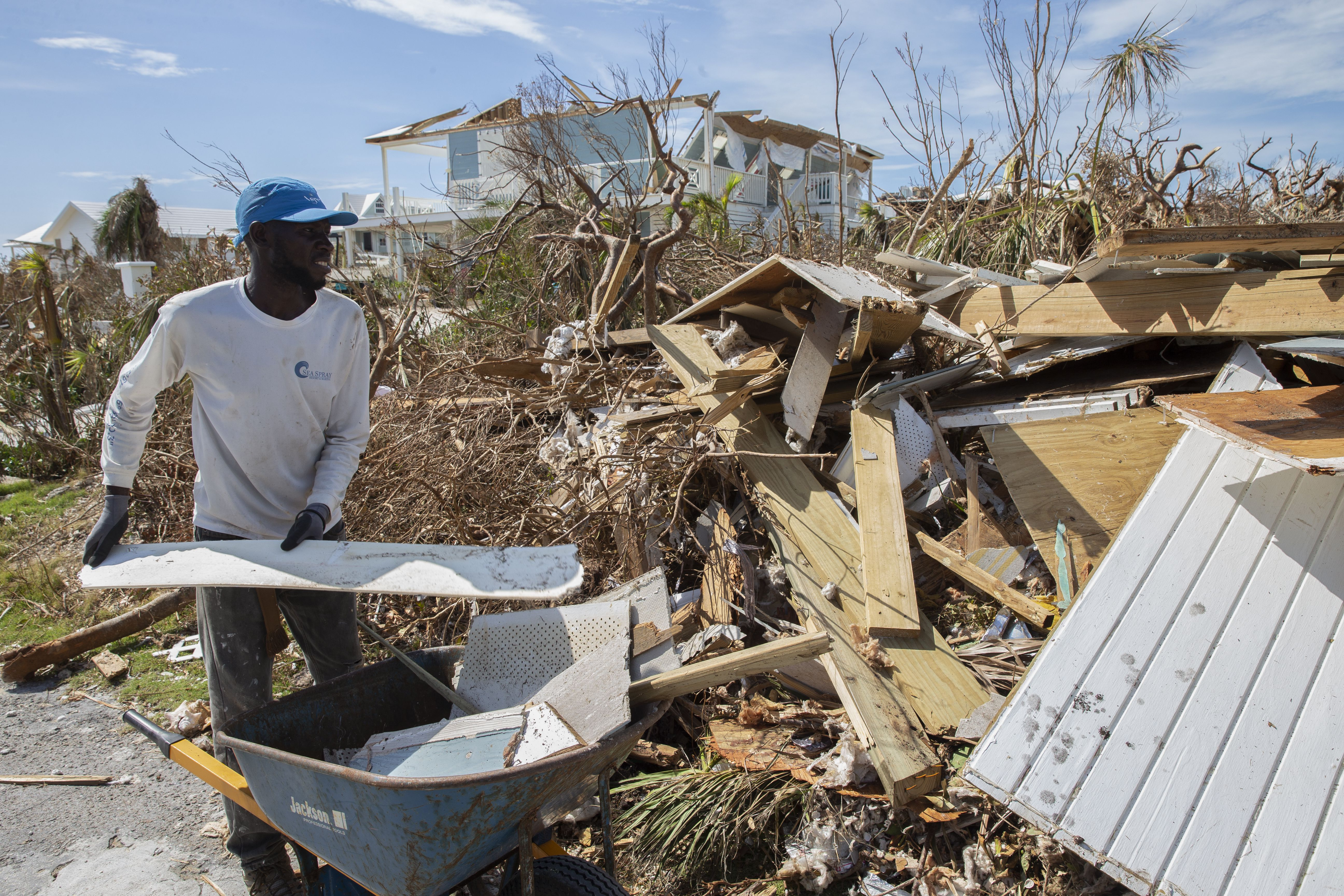 Eludieu Jnnoel collects rubble and debris from damaged homes after hurricane Dorian devastated Elbow Key Island on September 8, 2019 in Hope Town, Bahamas.