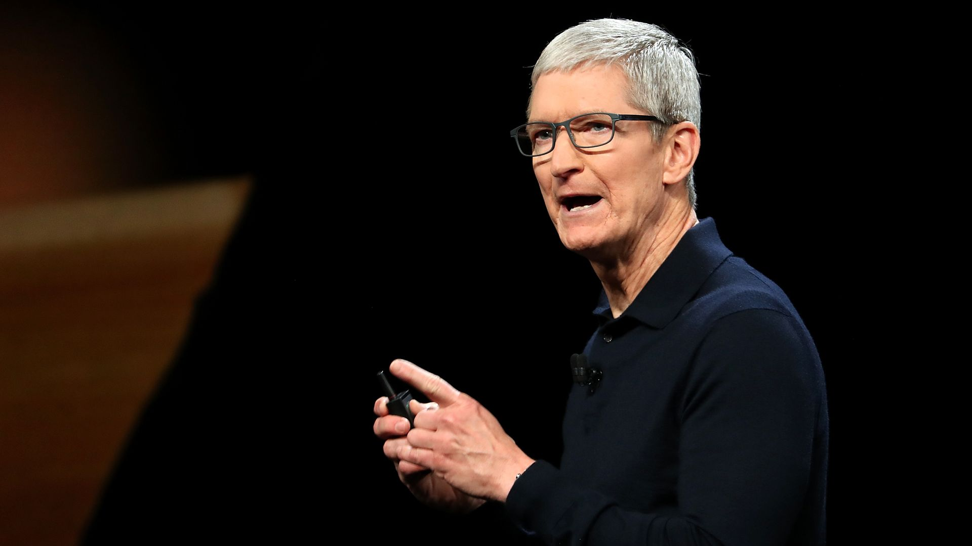 Tim Cook on stage at an event.