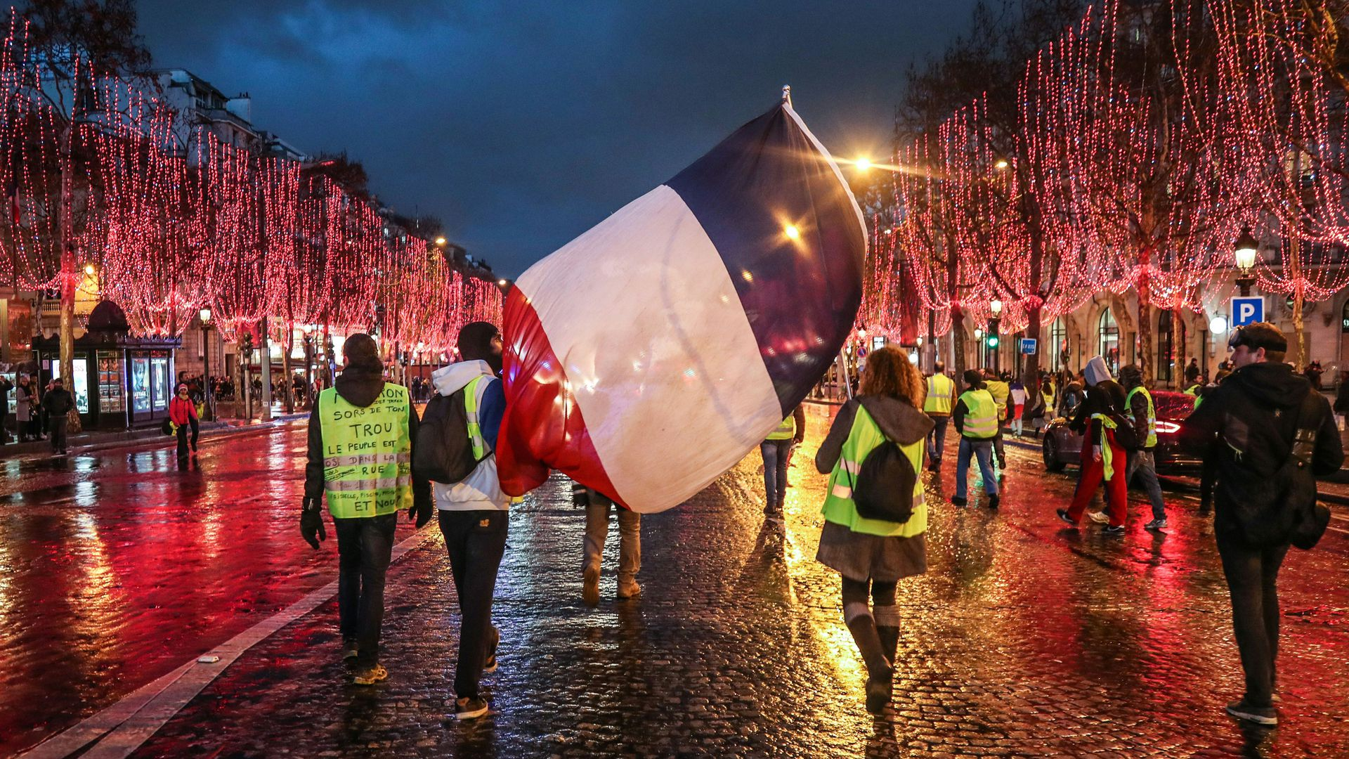 Yellow vest protestors carry French flag