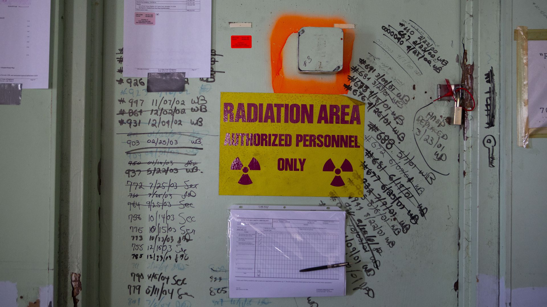 A red on yellow radiation warning sign on a former nuclear power plant at Fort Belvoir, Va.