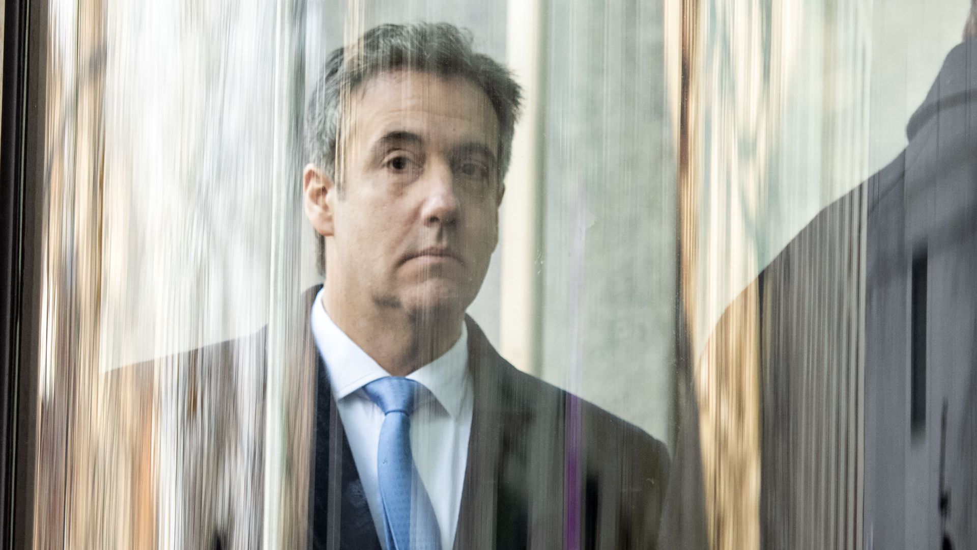 Michael Cohen behind glass