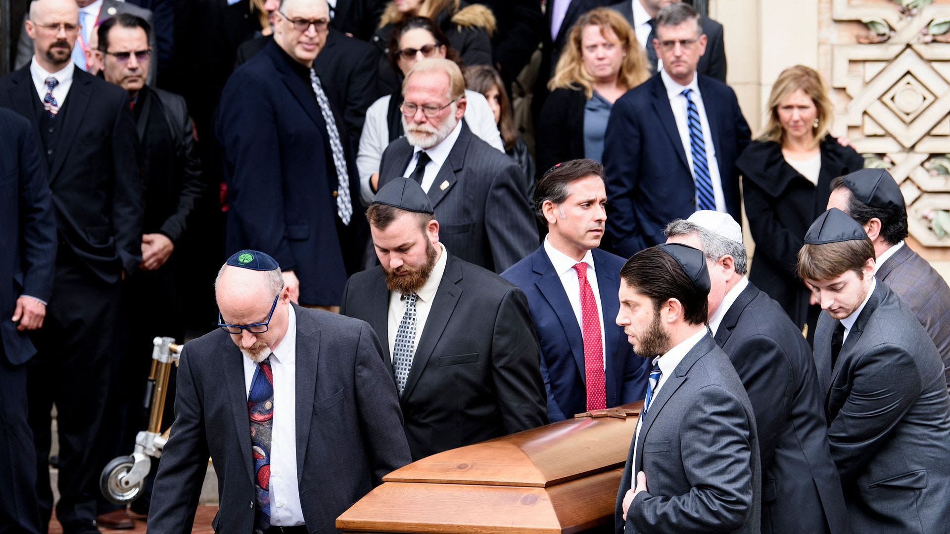 Pallbearers carry a casket from Rodef Shalom Congregation after a funeral for Cecil Rosenthal and David Rosenthal in Pittsburgh.