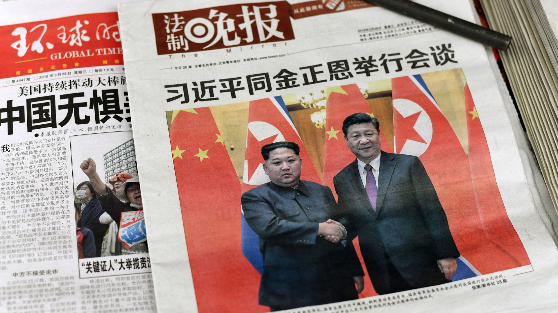 Chinese newspapers with photo of Xi Jinping and Kim Jong-un on cover