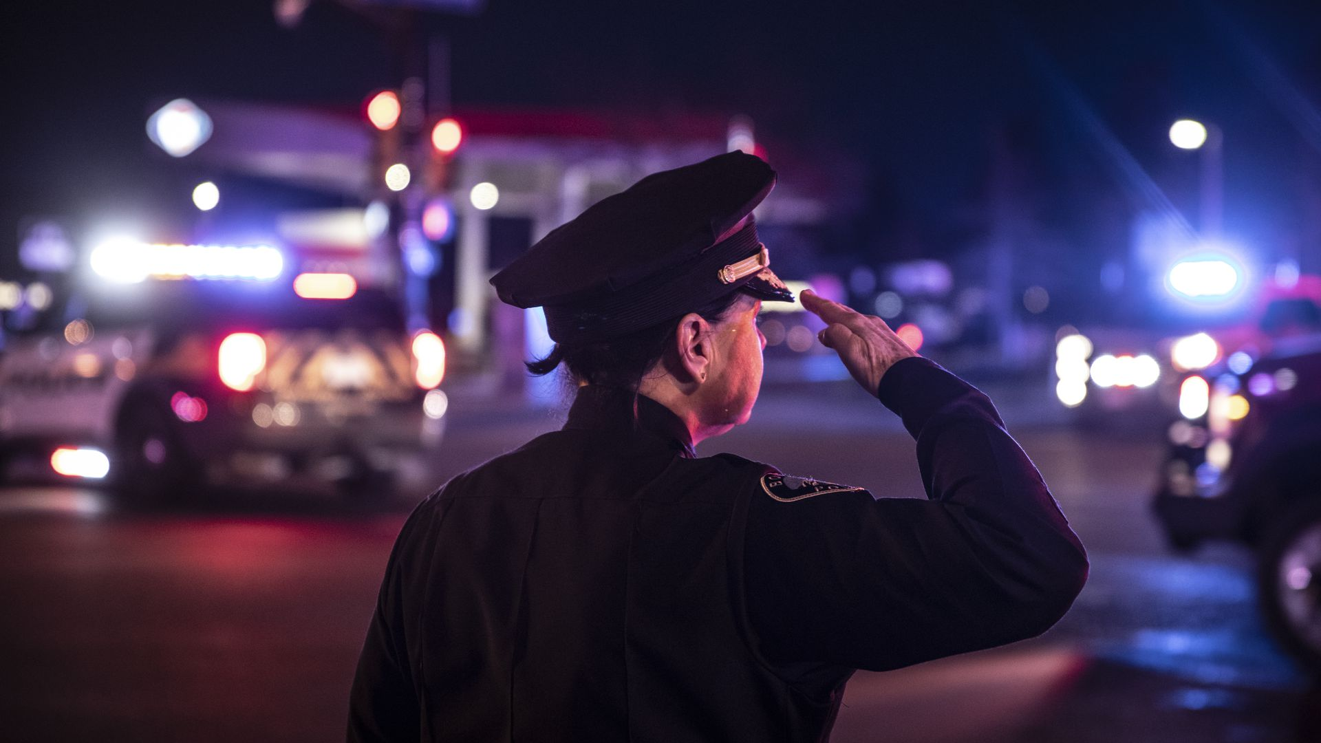 A photo of a police officer doing a salute.