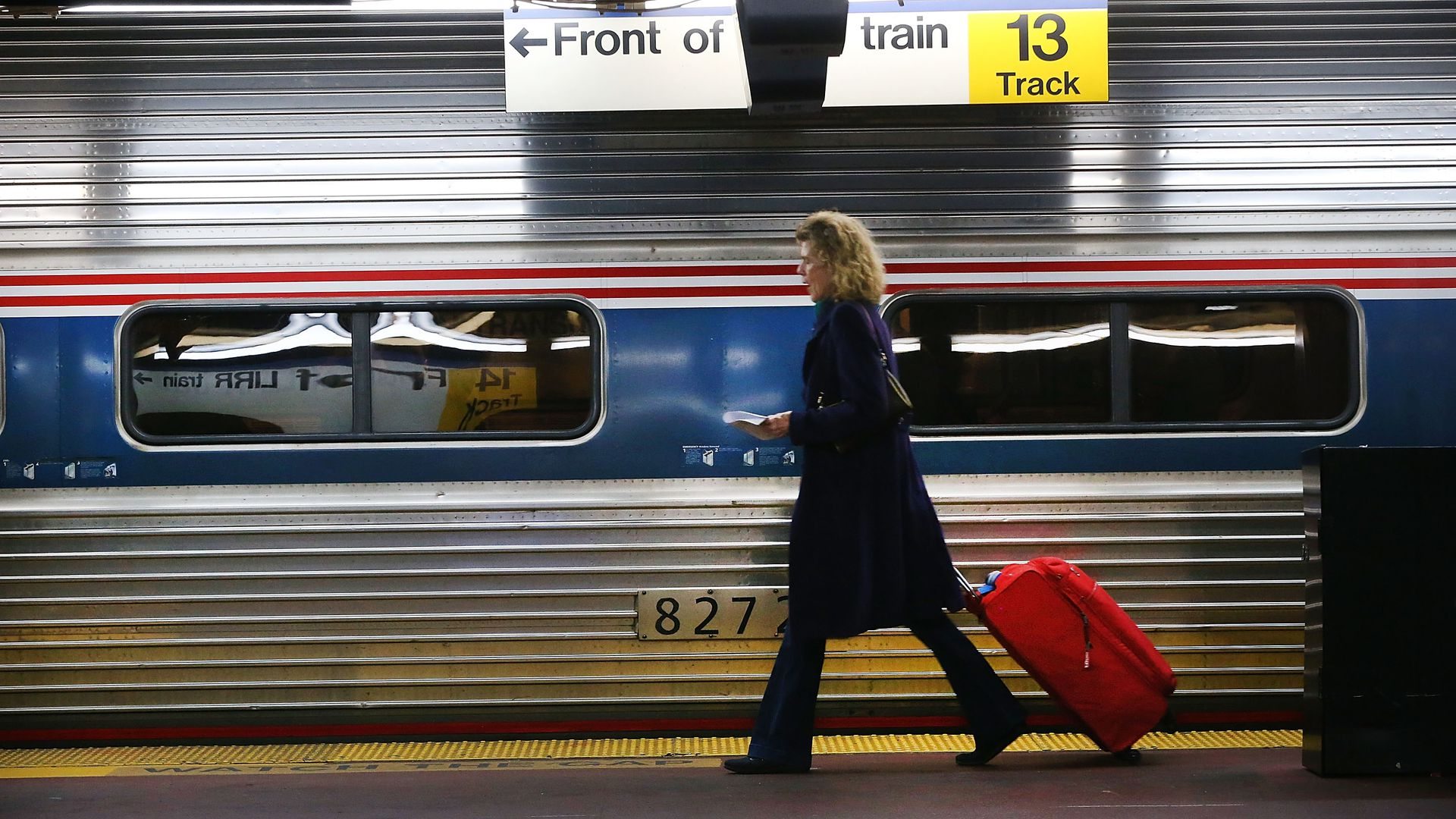 Woman boarding amtrak train