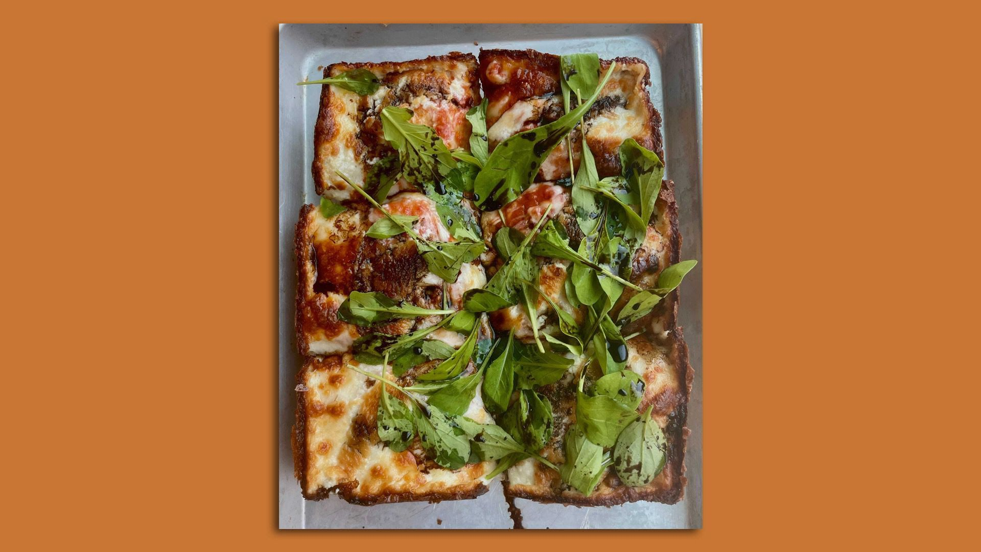 A Detroit-style pizza topped with arugula from Minneapolis' Wrecktangle Pizza.