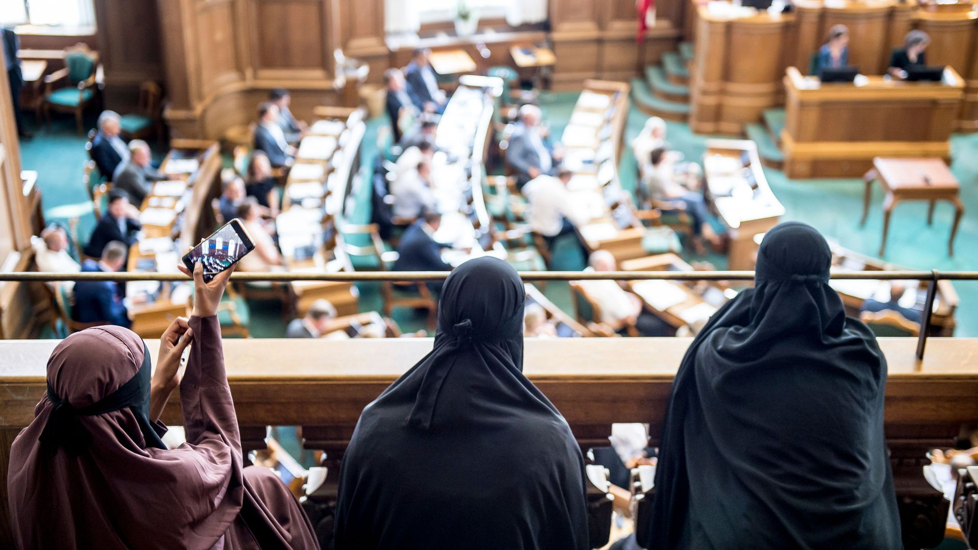 Women wearing niqab sit in the audience at the Danish Parliament in Copenhagen, Denmark.