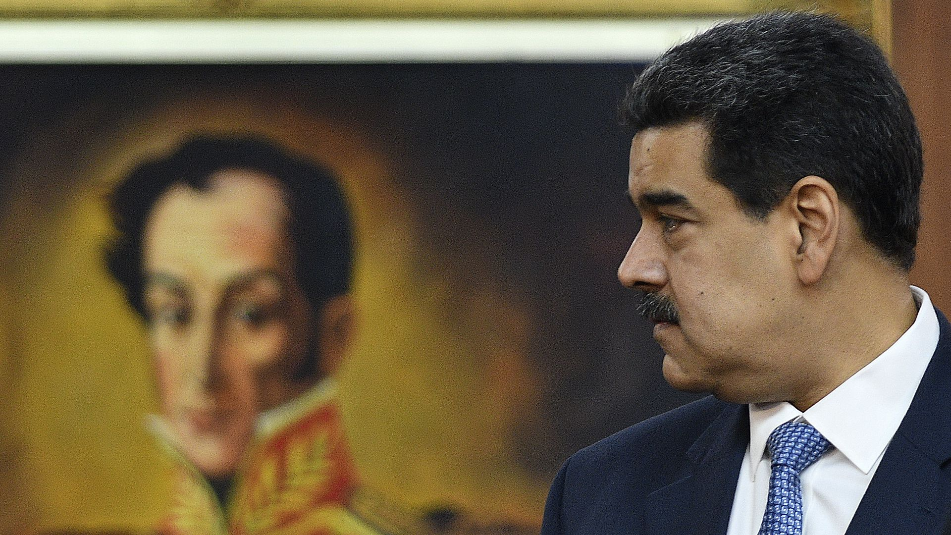 Maduro looking to his right.