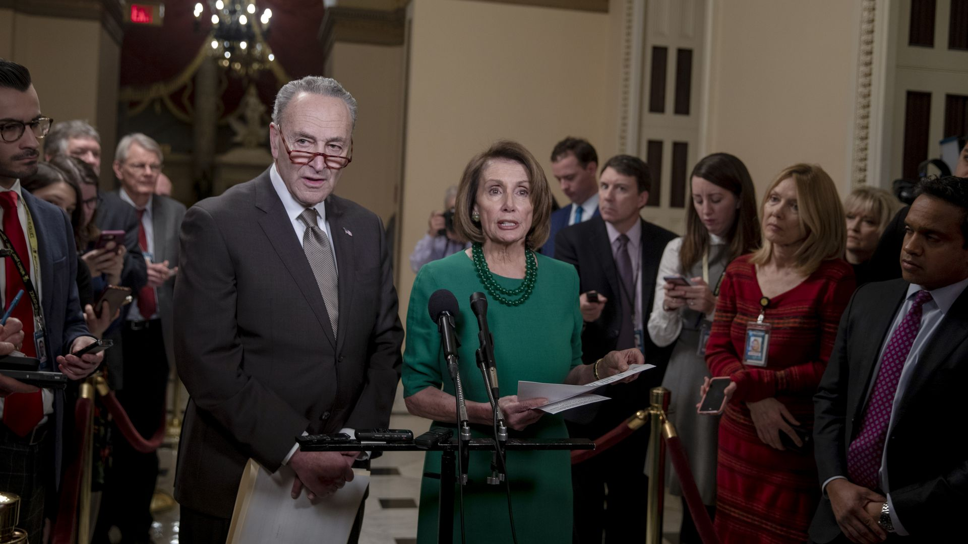 Chuck Schumer and Nancy Pelosi look flabbergasted.