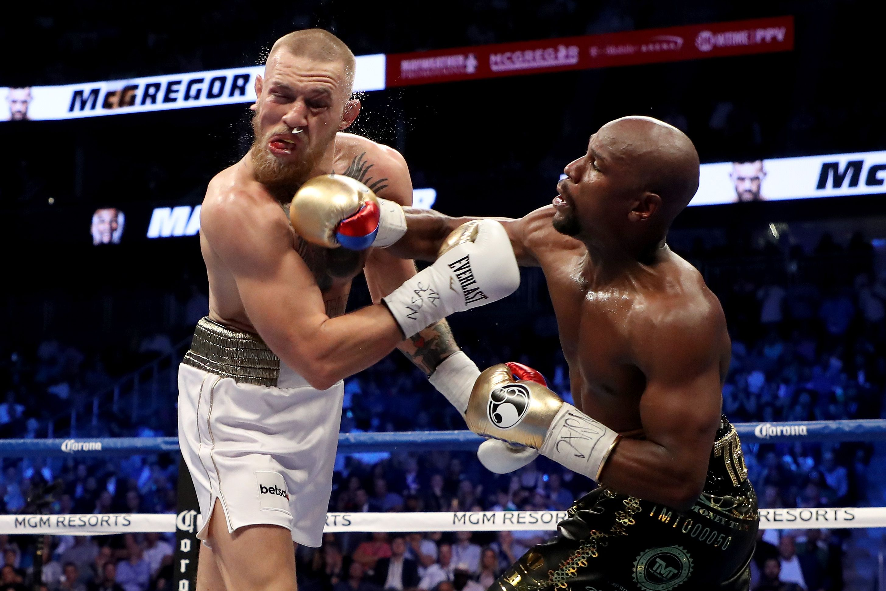 Floyd Mayweather punches Conor McGregor