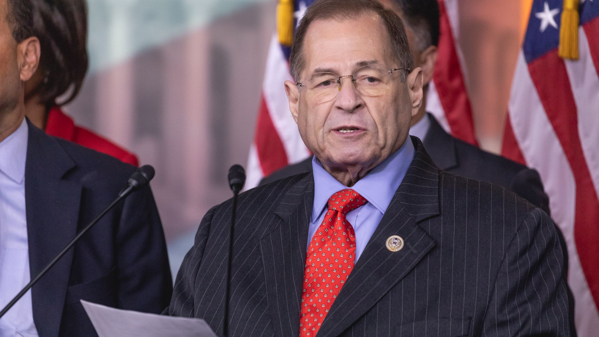 Rep. Jerry Nadler standing at a podium in the Capitol building wearing a red tie.