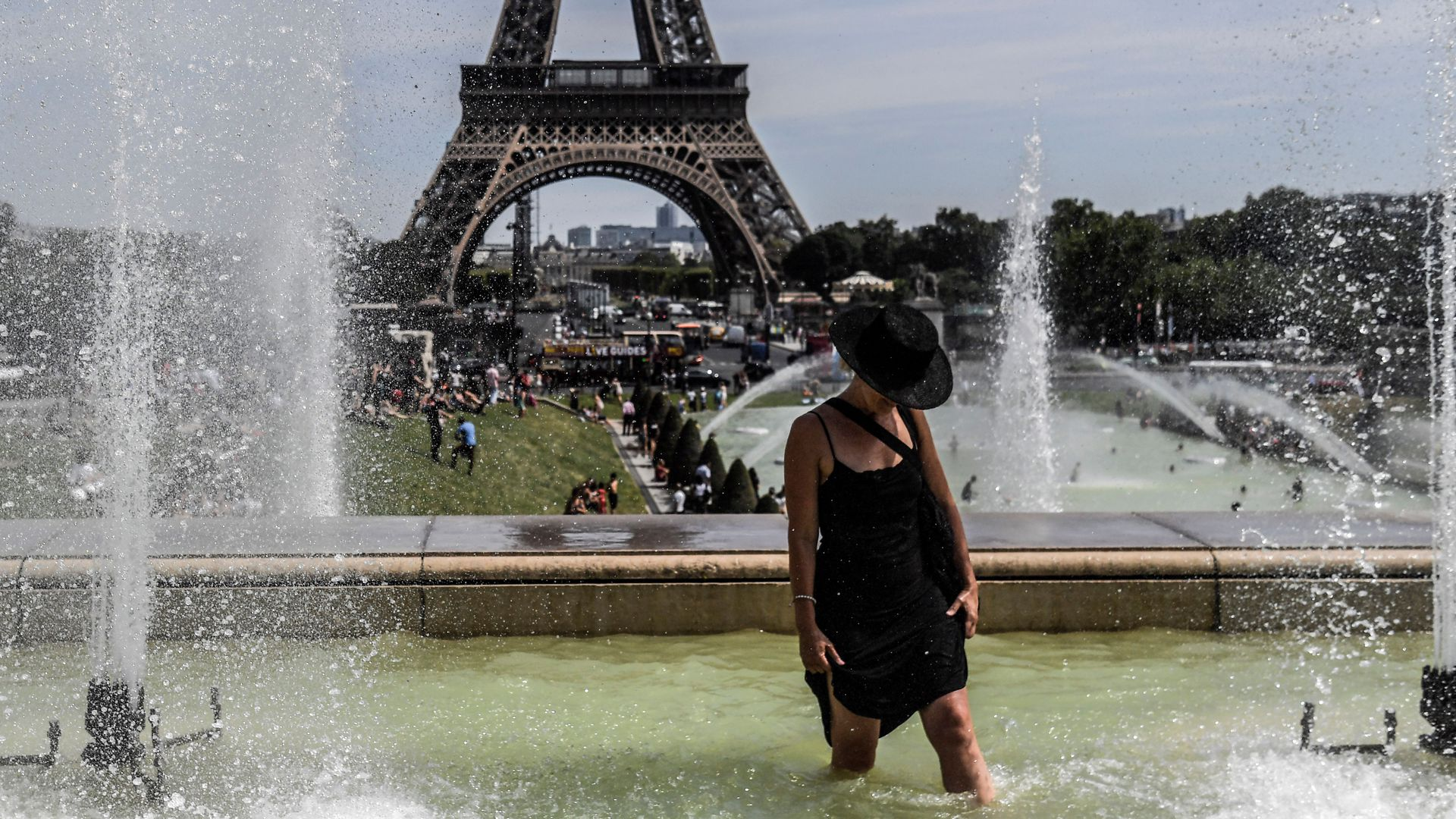 A woman cools off at the Trocadero Fountains near the Eiffel Tower in Paris, on July 22.