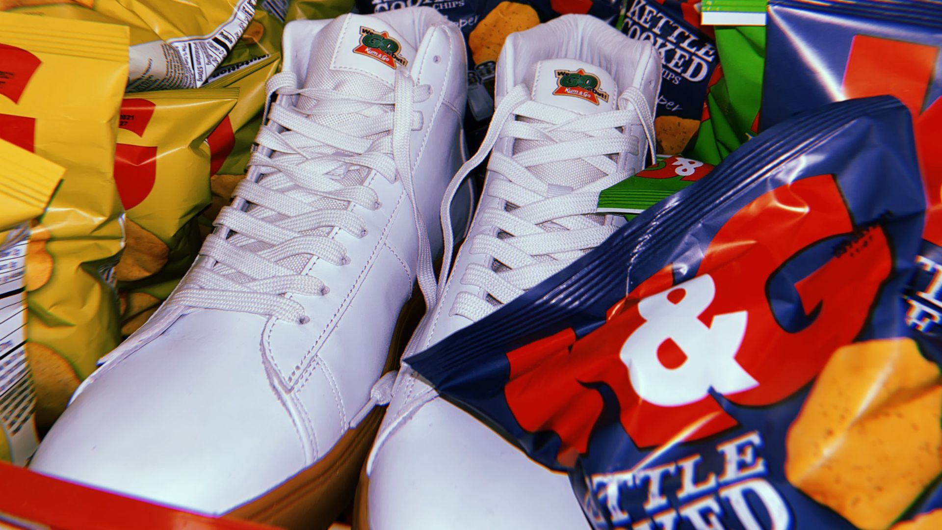 White sneakers surrounded by bags of chips