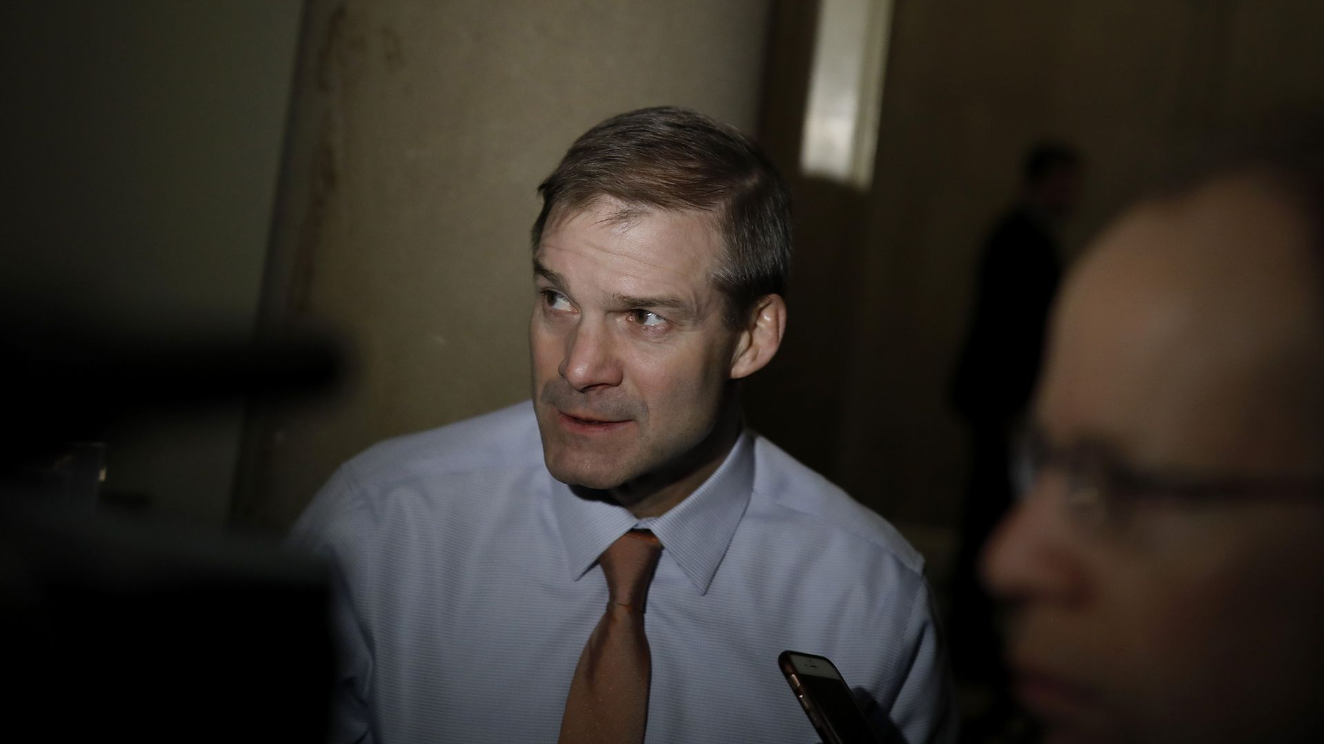 Jim Jordan highlighted in the center of a dark shadow