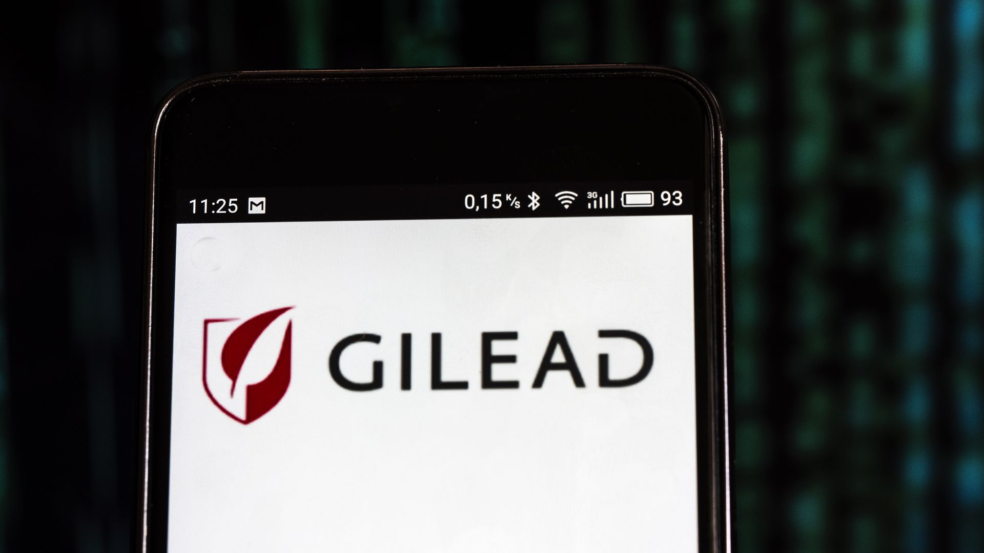 Gilead Sciences logo on a cell phone screen.