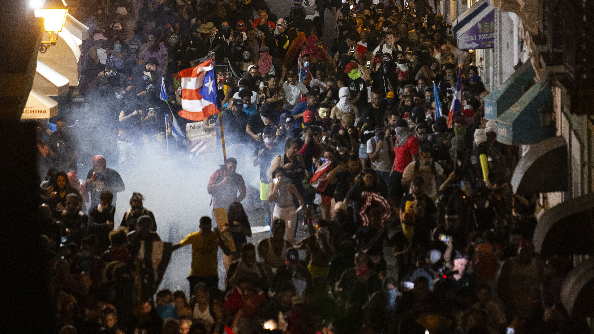 Police clash with protesters in front of the governor's mansion on July 23, 2019 in Old San Juan.