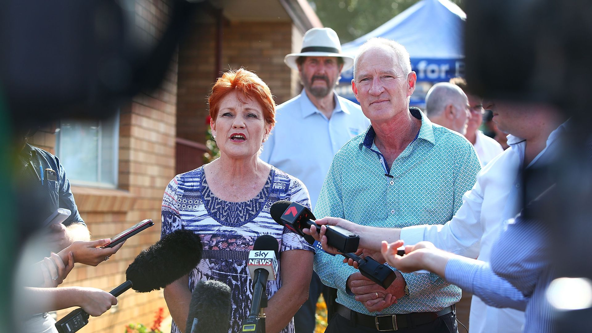 One Nation leader Pauline Hanson and party official Steve Dickson address the media.