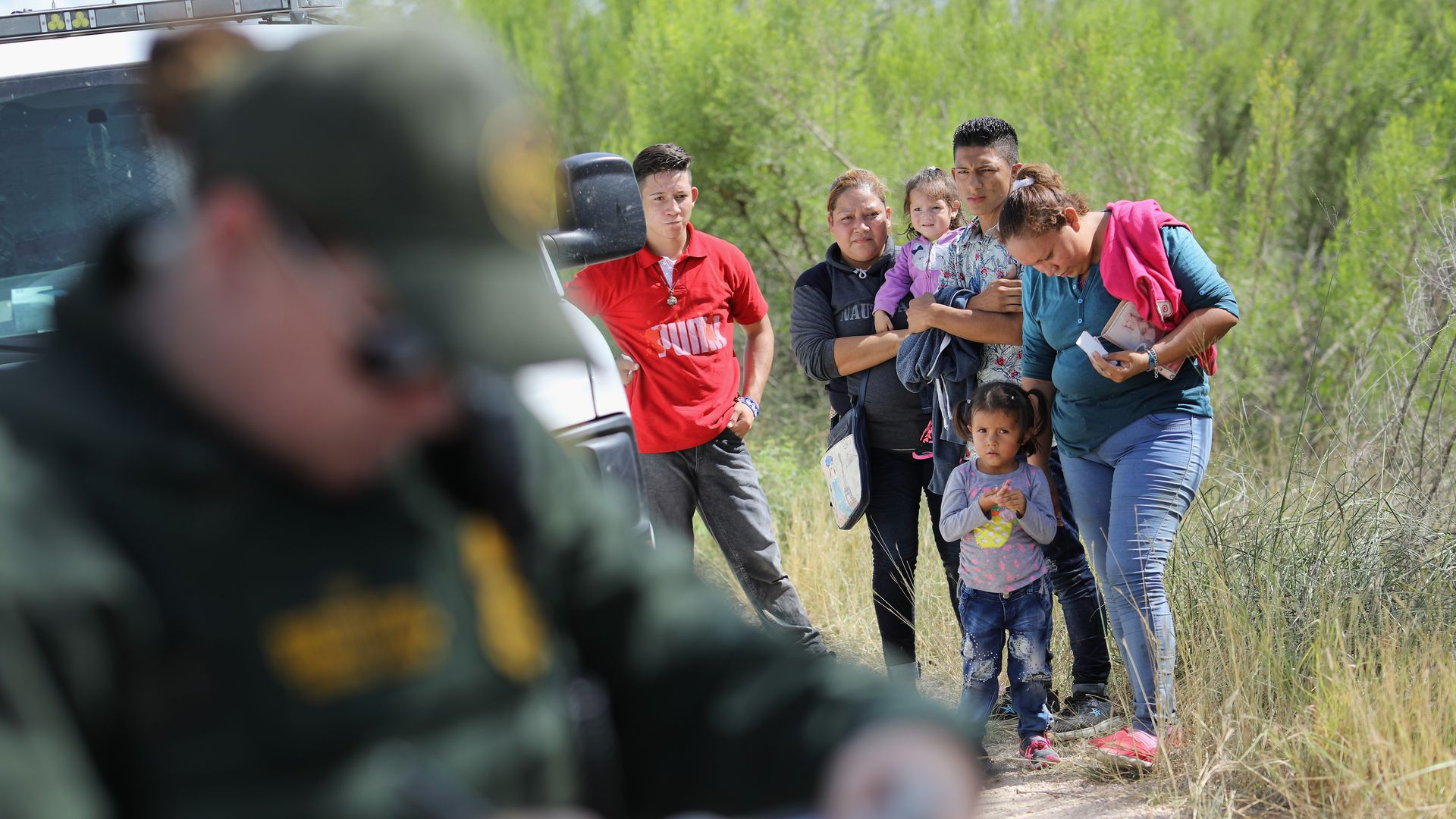 Central American asylum seekers wait as U.S. Border Patrol agents take groups of them into custody near McAllen, Texas last week. Photo: John Moore/Getty Images