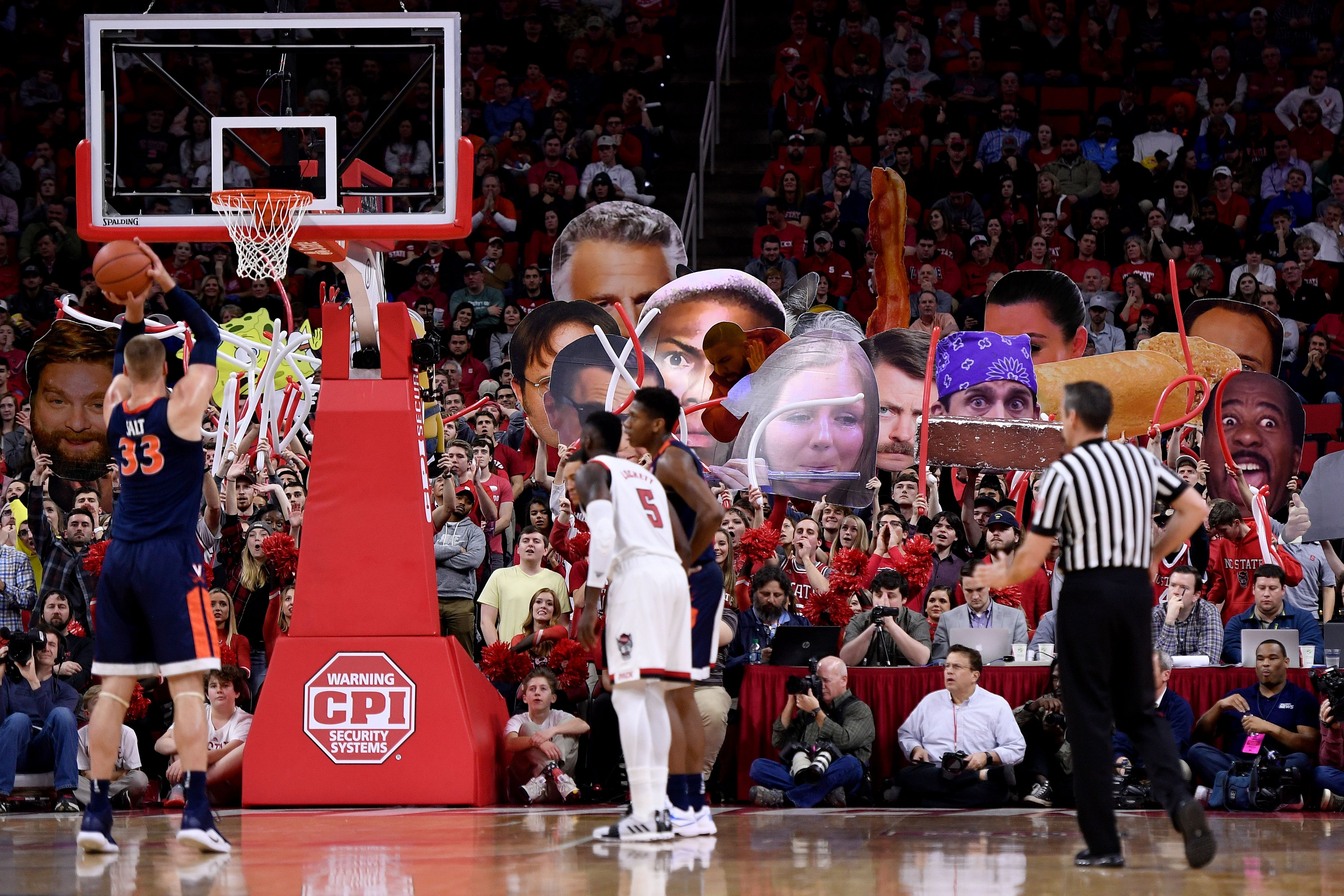 NC State fans try to distract a UVA player at the free throw line