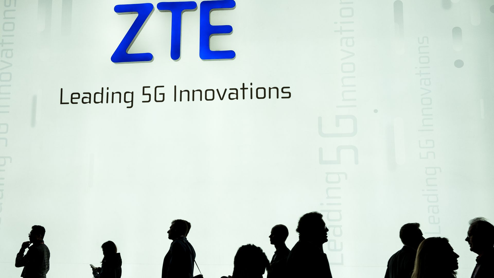 ZTE logo on white wall at a corporate event