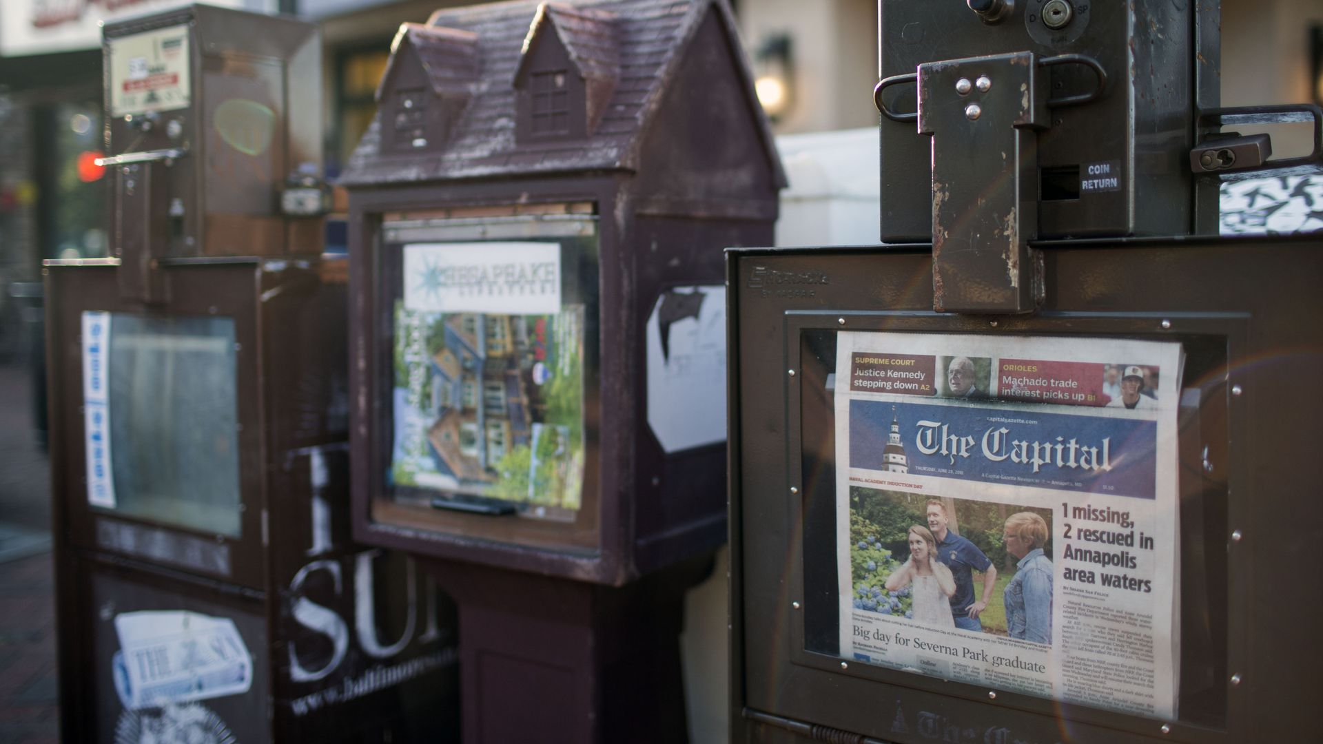 A newspaper stand selling the Capital Gazette.