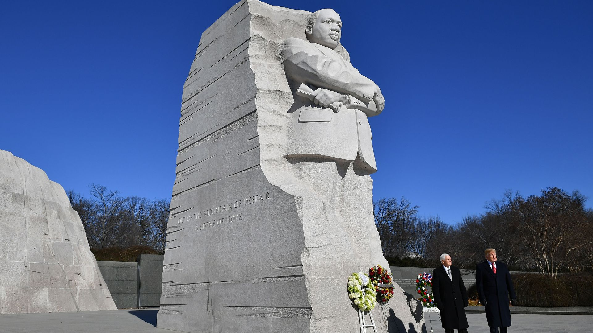President Trump and Vice President Mike Pence stand in front of the Martin Luther King statue at the King memorial
