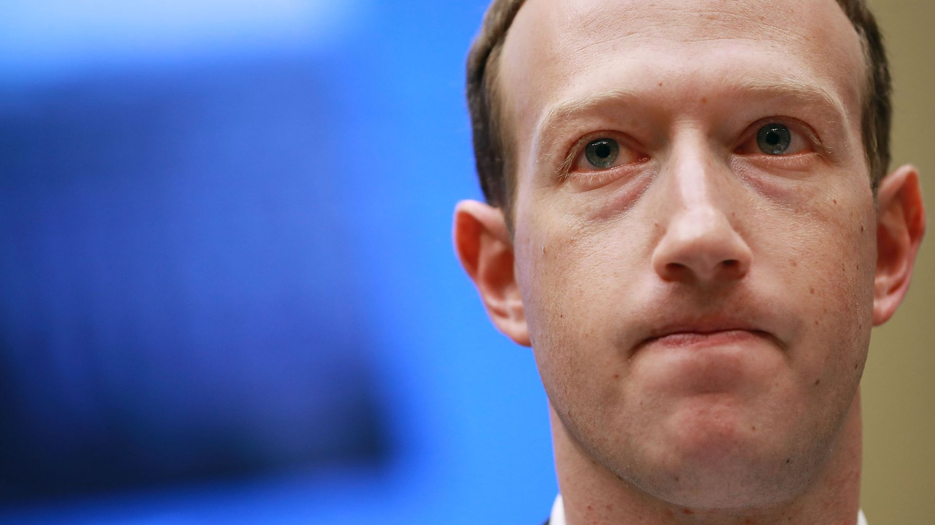 Facebook CEO Mark Zuckerberg grimaces