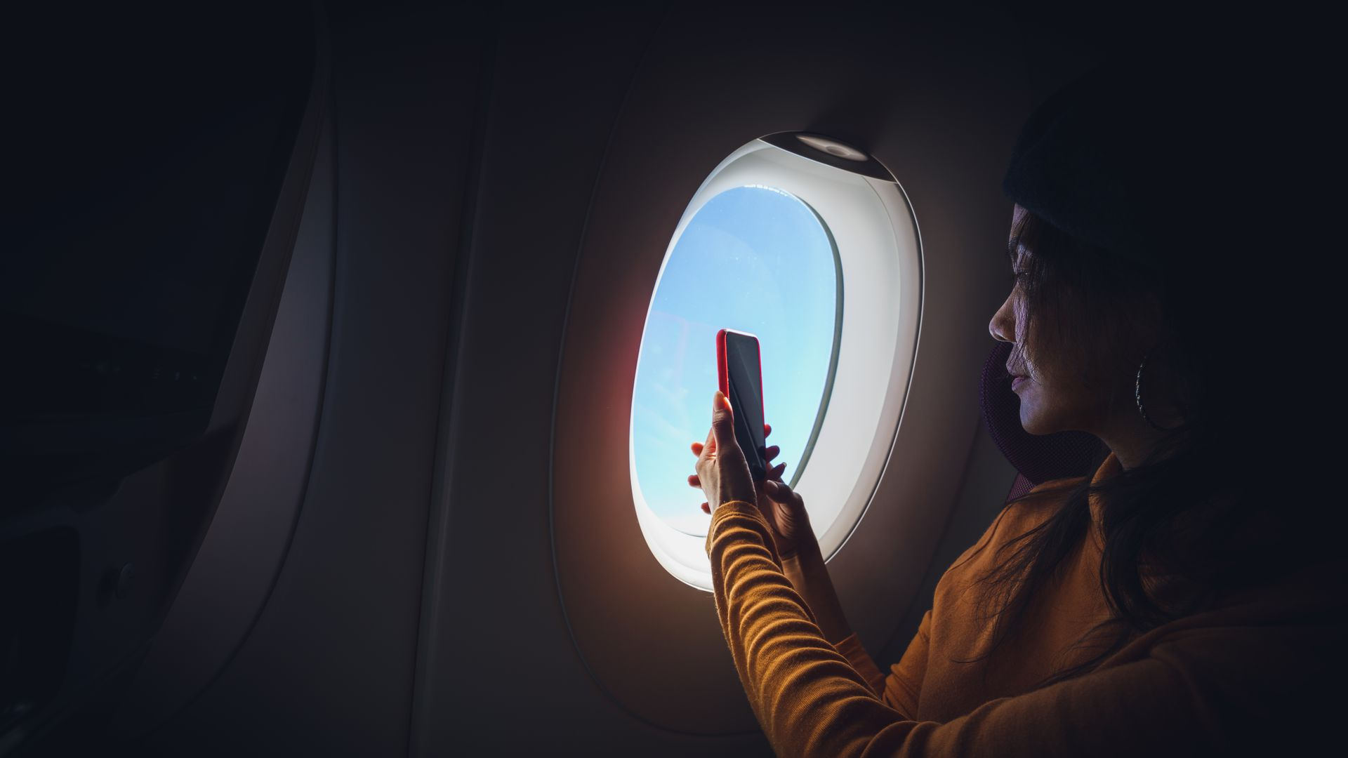 A passenger taking photos from their window seats.