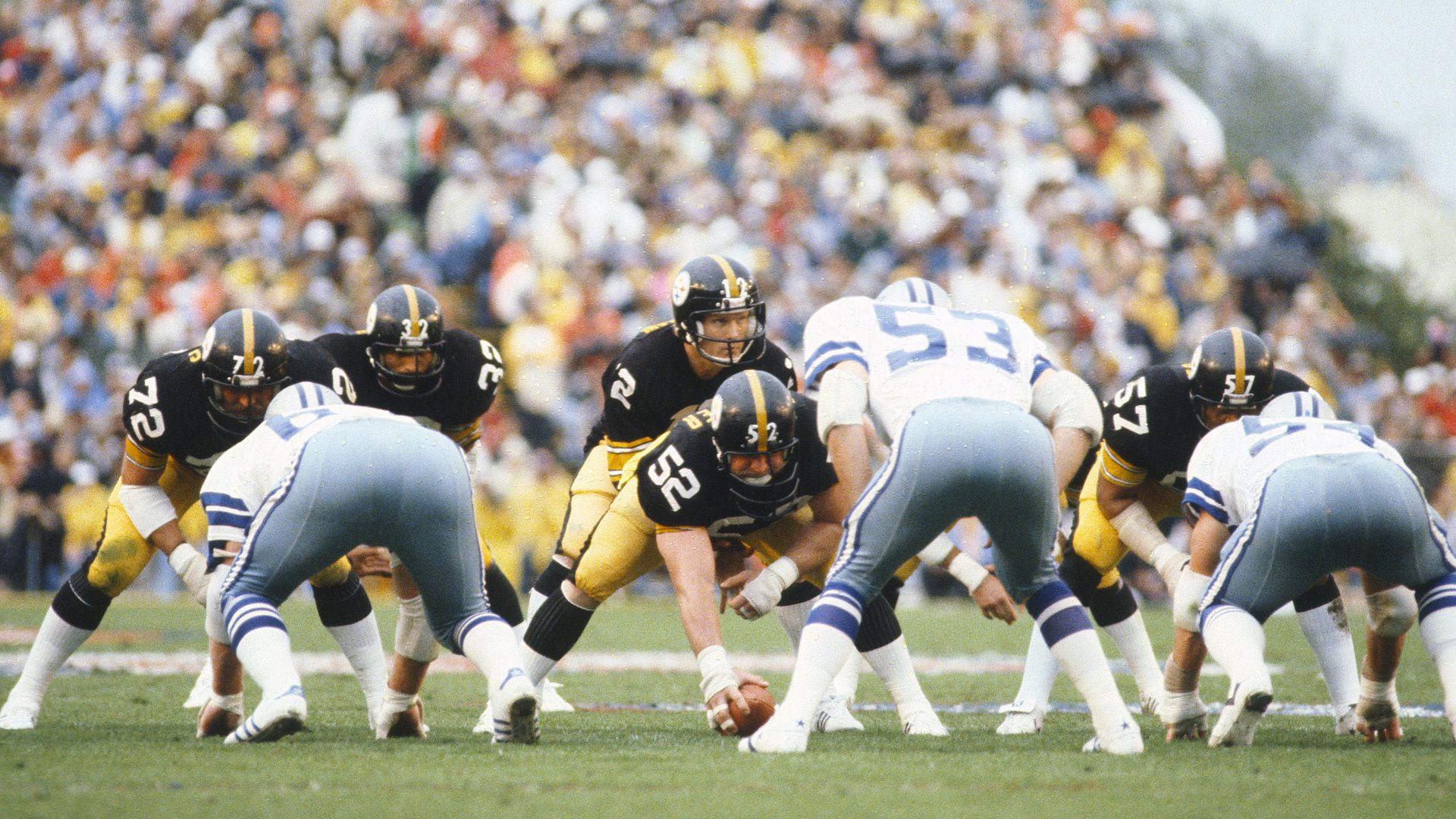 Terry Bradshaw #12 and Mike Webster #52 of the Pittsburgh Steelers against the Dallas Cowboys during Super Bowl XIII.