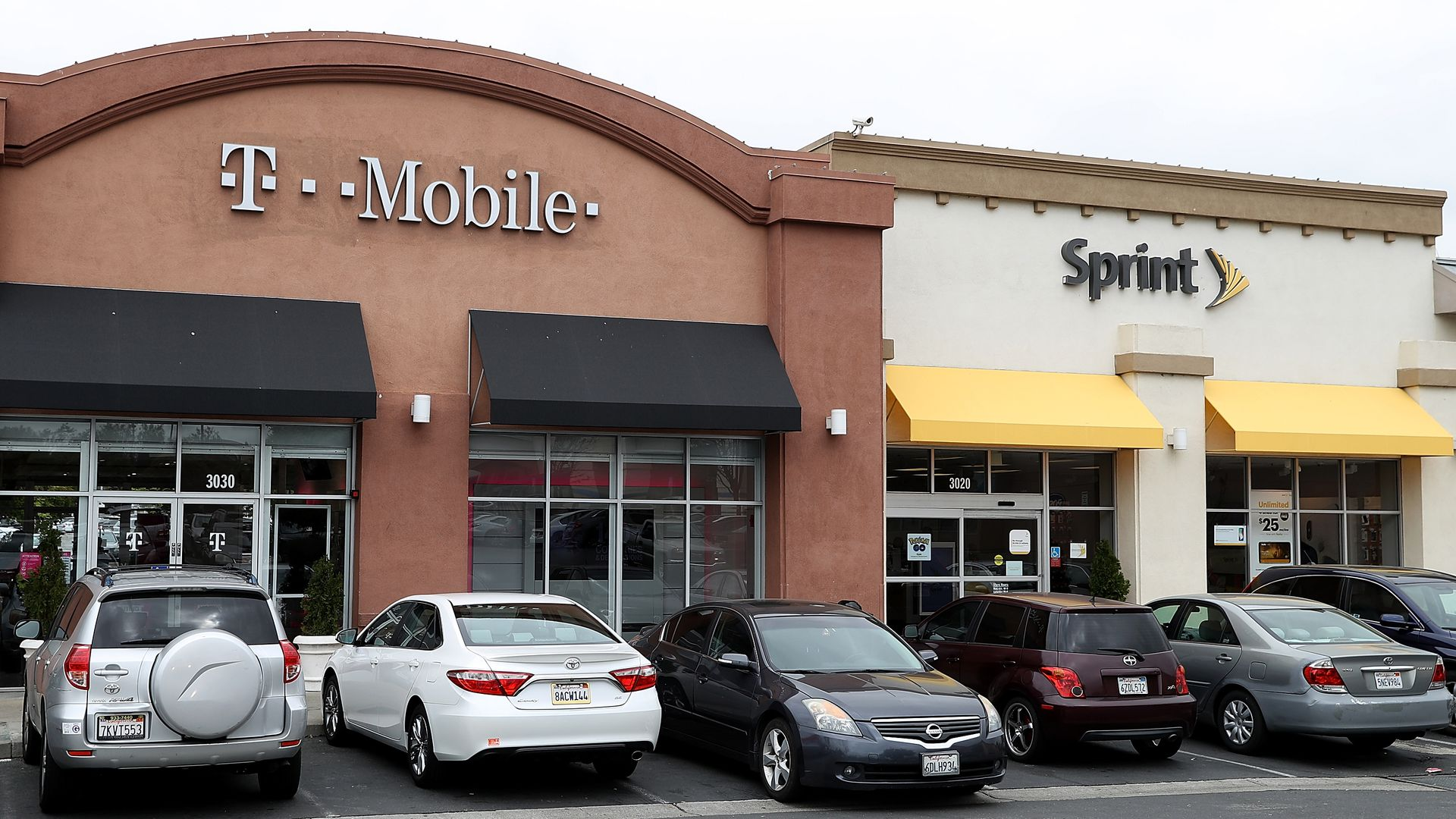 A T-Mobile and Sprint store next to each other