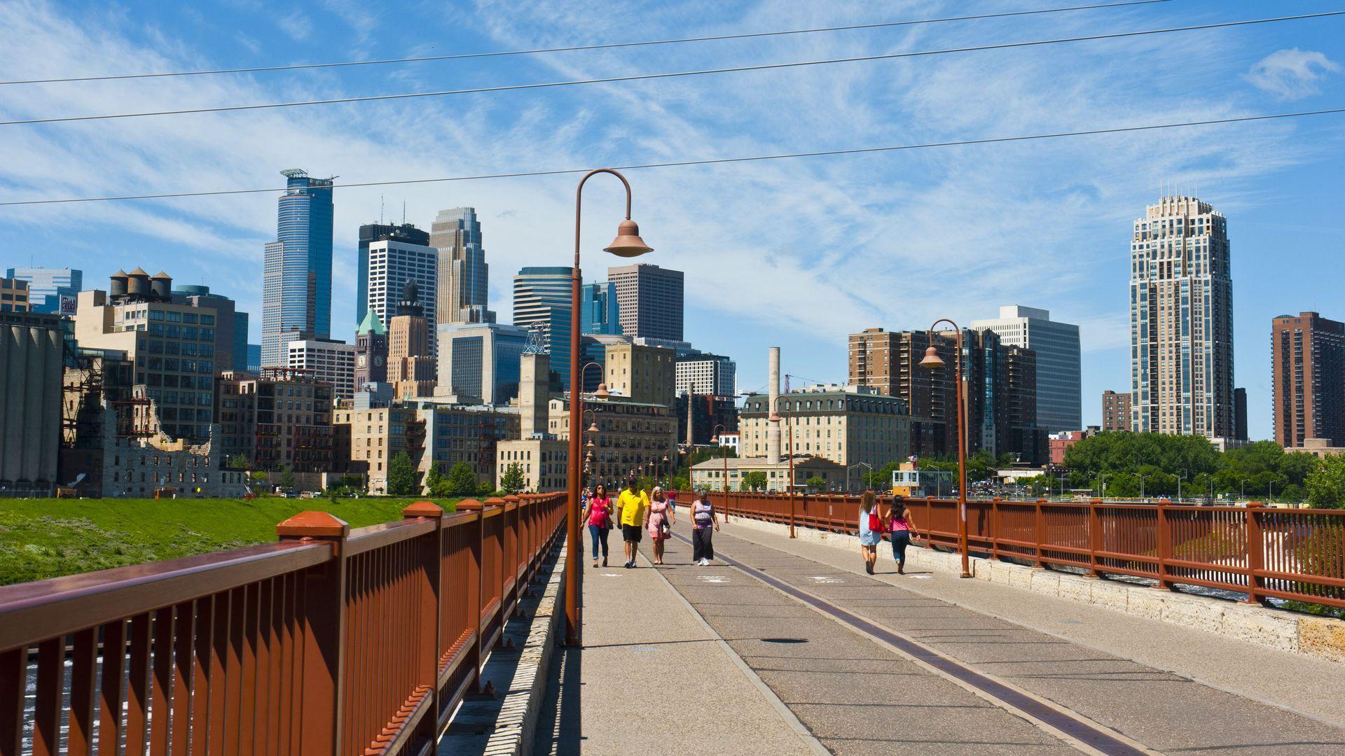 A bridge and the skyline of Minneapolis.