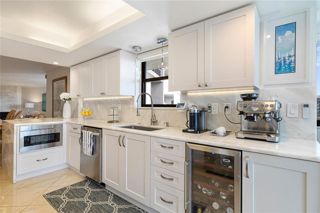1600 Gulf Blvd #517 gourmet kitchen with quartz counters and high-end appliances