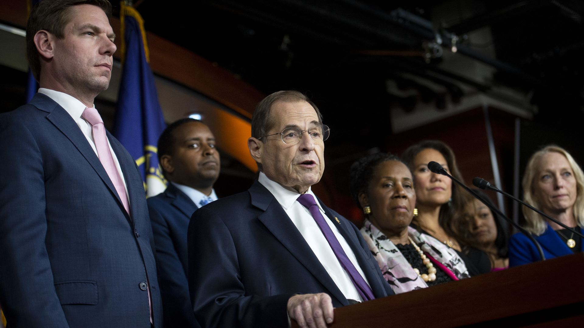 This image shows Nadler standing behind a podium and speaking at a press briefing.