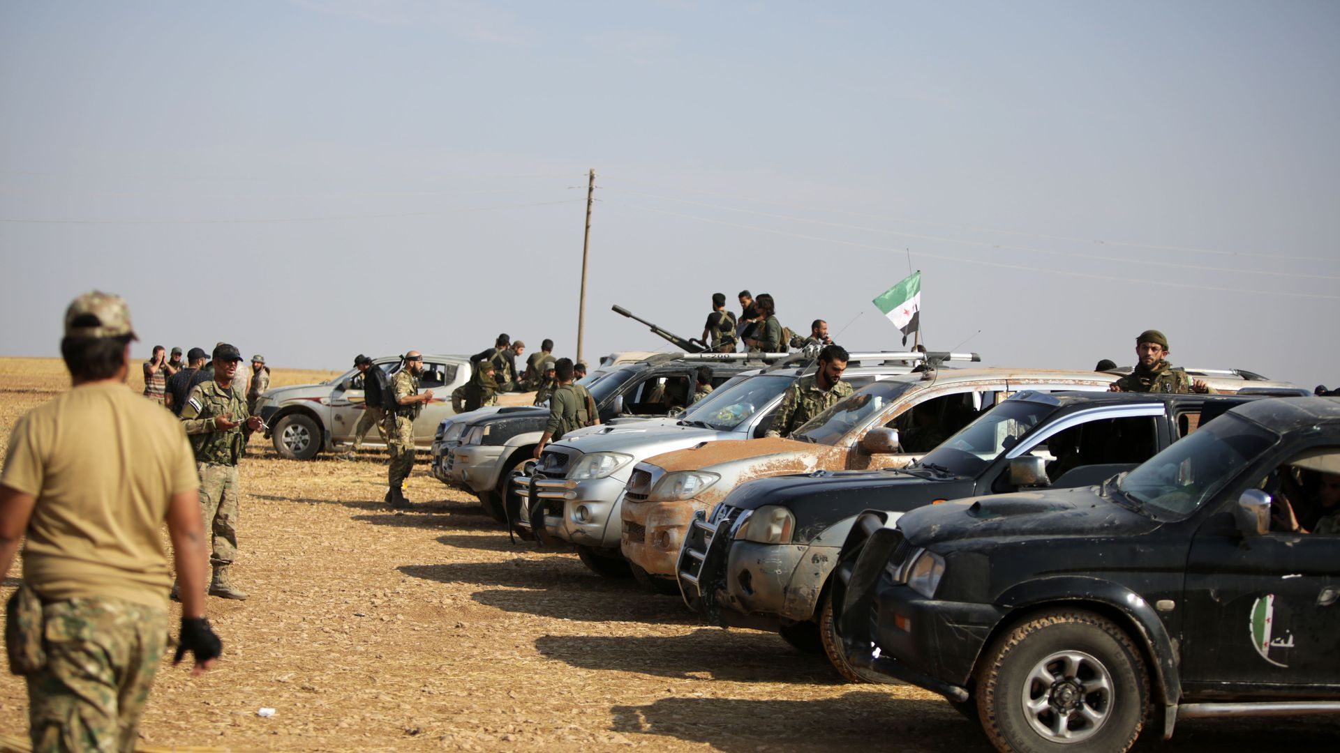 fighters in and around a small fleet of cars and trucks