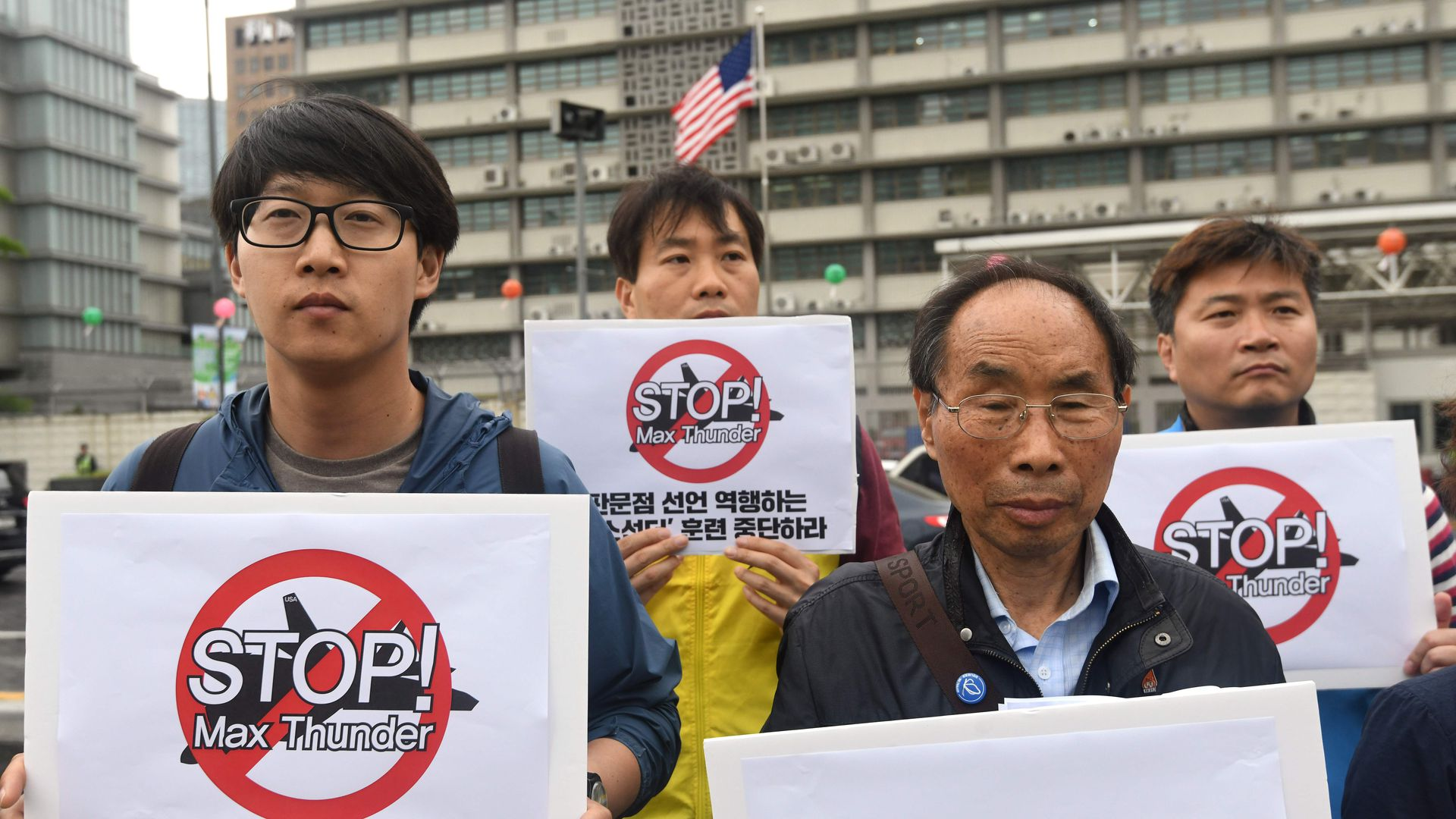 South Korean peace activists hold placards reading 'Stop! Max Thunder,' during a rally denouncing South Korea-US joint military drills, in front of the US embassy in Seoul on May 16, 2018.